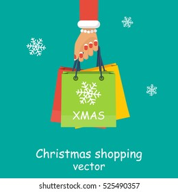Christmas shopping. Girl, woman hold in hand packages, gifts. Big Christmas sales. Vector illustration flat style design. Discounts for holidays. Buyer with many packages.