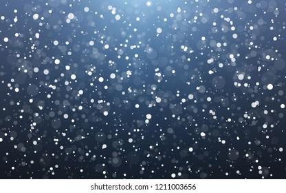 Christmas snow. Falling snowflakes on blue background. Snowfall. Vector illustration.