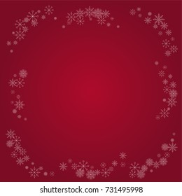 Christmas snow powder frame or border of a random scatter snowflakes on a red background. Snow explosion. Ice storm.
