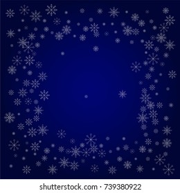 Christmas snow powder frame or border of a random scatter snowflakes in blue. Snow explosion. Ice storm.
