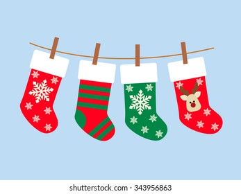 Christmas Socks vector background. Various Christmas socks hanging on a rope.