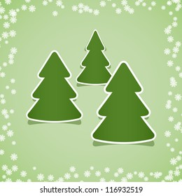 Christmas stickers with snowflakes on a green background.