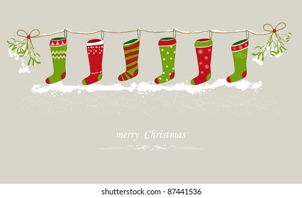 Christmas stockings hanging on a festive line