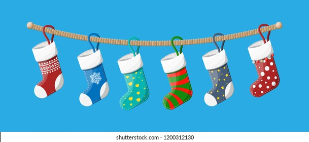 Christmas stockings in various colors on rope. Set of christmas cloth socks. Hanging holiday decorations for gifts. New year and xmas celebration. Vector illustration in flat style