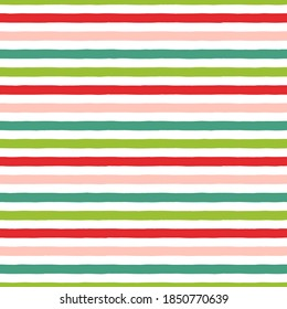 Christmas stripe seamless pattern. Green, red, pink hand drawn stripes on white background. Holiday wrapping paper pattern.