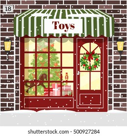 Christmas Toy shop toy store facade. Brown bricks. Decorated and illuminated cozy showcase with gift boxes, toys, Nutcracker, rocking-horse wreath, balls, xmas tree, snowflakes. Vector illustration