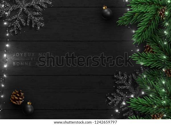 Christmas tree background. Xmas decoration design, bauble ball, snowflake color black, white light garland, pine cone, fir branches.  Flat lay,  French text Joyeux Noel, Bonne année.