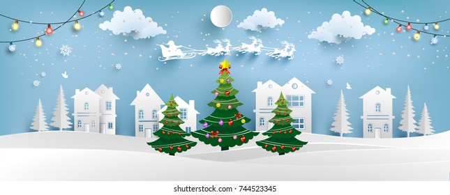 Christmas tree with beautiful lamps decorate the tree. there are homes and snowy hills. design paper art and crafts