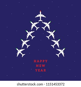 Christmas tree concept created by airplanes. Happy new year. Top view.