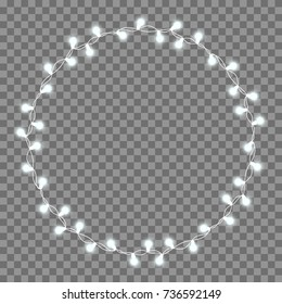 Christmas tree string garland in circle shape and text space isolated on background. Realistic Christmas, New Year party decorations with transparency. Light bulb decor. Lights border.