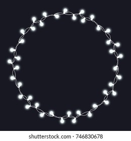 Christmas tree white string garland in circle shape and text space isolated on dark background. Realistic Christmas, New Year party decorations with transparency. Light bulb decor. Lights border