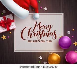 Christmas vector background template with merry christmas greeting text in white space and colorful elements like santa hat, gift and balls in wood texture background. Vector illustration.
