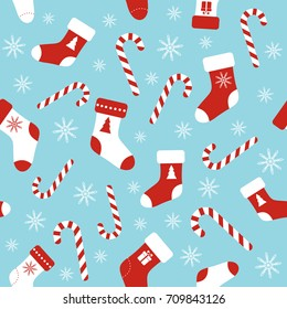 Christmas vector seamless blue pattern with candy canes, christmas socks and snowflakes. Background for wrapping paper, fabric print, greeting cards design