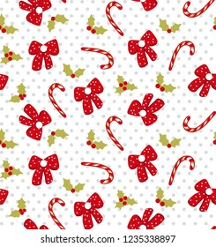 Christmas vector seamless pattern with candy canes, bows and holly on background in dots.