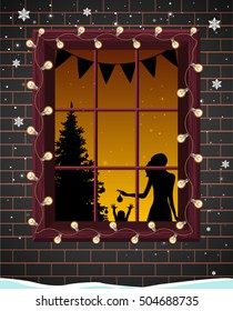 Christmas window with tree silhouette,mother and her child. They decorated room and New Year tree for Christmas. Happy family wait for Christmas. Brick wall,garland and snow outside. Winter evening.