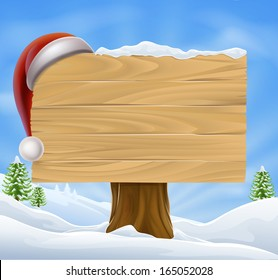 A Christmas wooden sign with a Santa Hat hanging on it in a snowy winter landscape