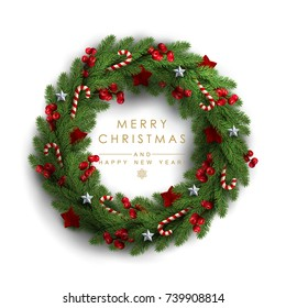 Christmas Wreath Made of Naturalistic Looking Pine Branches Decorated with Red Berries, Wooden Stars and Candy Canes.