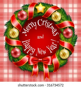 Christmas wreath on a red plaid background