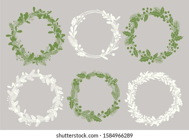 Christmas wreaths silhouettes vector illustrations set. Stylish white and green frames isolated on grey background. Empty ilex and fir twigs round borders with text space. Decorative Xmas elements.