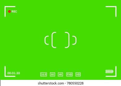 Chroma key modern digital video camera focusing screen isolated on green background