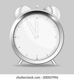 Chrome alarm clock with five to twelve
