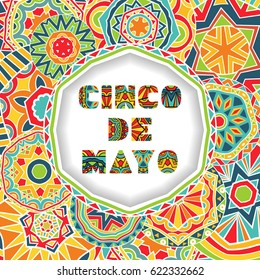 Cinco De Mayo card with greetings lettering and ornate background. Round cut border with shadow effect and abstract Mexican style ornament. Bright ethnic pattern. Vector illustration.