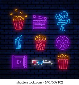 Cinema, bright neon signs, logos, emblems, labels. Signs for web direction, advertising design, banner and more. Icons popcorn, camera, slapstick, soda, 3D glasses, reel and movie icon.