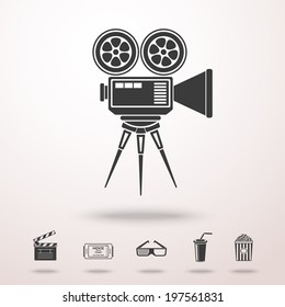 Cinema camera detailed vector monochrome icon in the air with shadow. With set of cinema icons - Film clapperboard, ticket, 3D glasses, plastic cup with straw, popcorn.