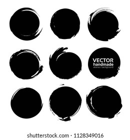 Circle abstract strokes of black paint isolated on a white background