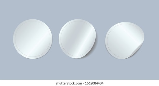 Circle adhesive symbols. White tags, paper round stickers with peeling corner, isolated rounded plastic mockup signs, vector illustration. Sticker mockup, advertising sale banners, ui ux web elements