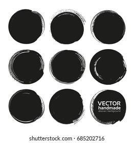 Circle black abstract thick textured paint smears isolated on white background