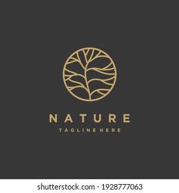 Circle tree gold minimalist logo design isolated on a black background inspiration