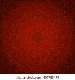 The circular symbol, the mandala. Decorative background with circular ornamental element on the background of red kraft paper. Ethnic ornament.