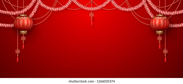 Classic Chinese new year background. Hanging silk lanterns and flower garlands on red background