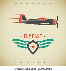 Classic flat looking fast plane and emblem with shield and wings