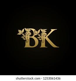 Classy BK initial letter floral shape golden logo