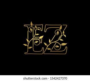 Classy  letter E , Z and EZ  Vintage Gold Floral Logo Icon, overlapping monogram logo, elegant luxury GOLD color on black background. Classy Letter Logo Icon.
