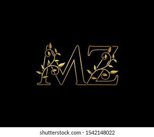 Classy  letter M , Z and MZ  Vintage decorative ornament emblem badge, overlapping monogram logo, elegant luxury gold color on black background