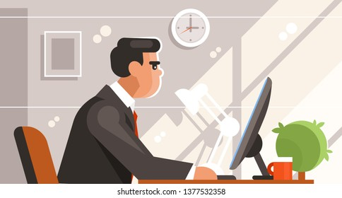 Clerk sitting at the computer. Side view. Businessman in the workplace