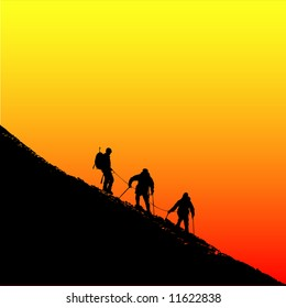 Climbers ascending a ridge at sunset in the alps