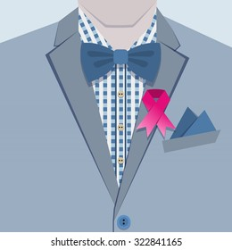 Close up of fashionable male in blue suit, checkered shirt, bow tie, and pink ribbon pin on collar