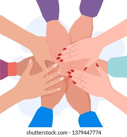 Close up image of young students making a stack of hands. Business startup and teamwork concept - diverse team putting their hands together.