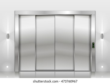 Closed door of the freight elevator hospital or office building. Metal armored sliding door.