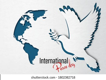 Closeup dove peace with a part of world map in paper cut out style and International Peach Day lettering on white paper pattern and navy blue background.