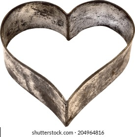 Close-up of a heart shaped pastry cutter, Heart shaped cookie cutter isolated on white background