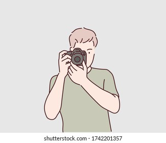 Closeup portrait of a young man taking a picture . Hand drawn style vector design illustrations.