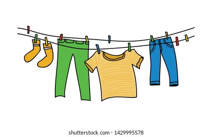 Clothes hanging from a wire to dry