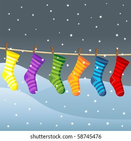 Clothes line for Christmas socks over snow field