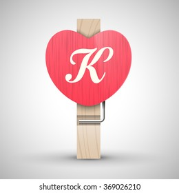 Clothes wooden heart pin with capital letter K vector illustration. Decorative wooden pin best for Valentines day. Alphabet letter.