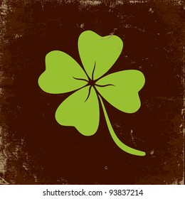 Clover with four leaves in brown background